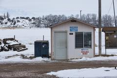 Rural US Post Office winter small town shack - stock photo
