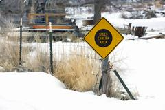 Rural community radar speed camera warning sign winter snow stylized Stock Photos