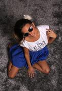 Beautiful Girl Model With Sunglasses on Silver Carpet - stock photo