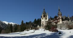 Ultra HD 4K Peles Castle in Sinaia, Romania, Winter Landscape, Cold Mountains Stock Footage