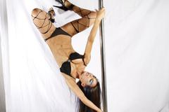 pole acrobat - stock photo