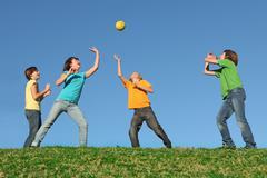 Active kids playing ball at summer camp Stock Photos