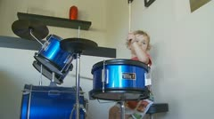 Side dolly young boy playing drums (6) model release Stock Footage