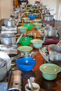 Cookware on long table Stock Photos