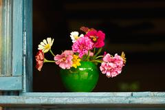 Colorful flowers in chinese pottery Stock Photos