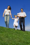 Happy healthy family walking, outdoors in summer Stock Photos