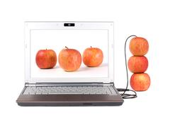 upload real apple from the laptop by usb - stock photo