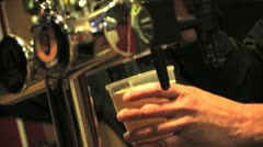 Close Up of Barman Pouring a Pint of Beer / Lager Stock Footage