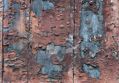 Wooden wall with flaking paint Stock Photos