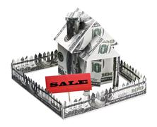 House made of money with a sign for sale Stock Photos