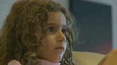 Side profile of girl watching TV (1) model release Stock Footage