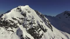 Close aerial snow covered mountain peak Stock Footage