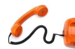 Hotline orange retro phone Stock Photos