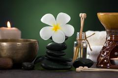 tropical frangipani spa health treatment with aroma therapy and hot stones - stock photo