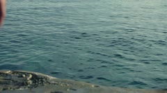 Young three men jumping into the sea, slow motion shot at 120fps Stock Footage