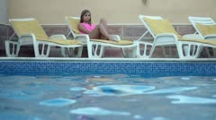 Young man diving in the swimming pool to the woman, slow motion shot at 240fps Stock Footage