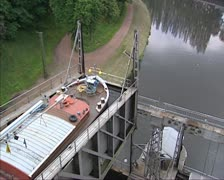 Boat lift at Bracquegnies Upper tank descends + pan to lower tank Stock Footage