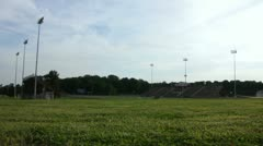 High School Football Stadium Extreme Wide Dolly Stock Footage