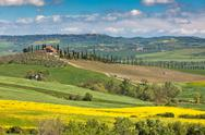 Stock Photo of outdoor tuscan val d'orcia green and yellow fields