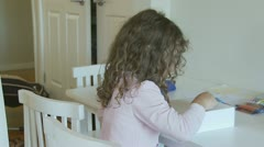 Young girl drawing, hidden face (2), dolly shot - model release Stock Footage