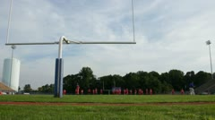 Football Players Practicing Wide Dolly - stock footage