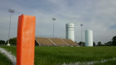 High School Football Stadium Orange Pylon Dolly In Stock Footage