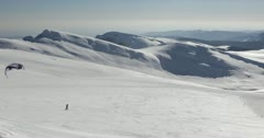 Ultra HD 4K Man Kiting, Winter Landscape, Ski Resort in Cold Mountains Stock Footage