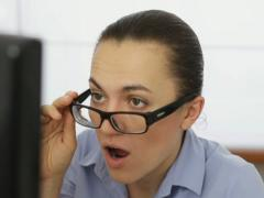 Shocked business woman in front of computer, close up NTSC - stock footage