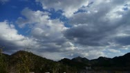 Panoramic of sunny mountains in fall autumn,Altocumulus cloud in blue sky. Stock Footage