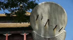 china ancient stone time measure instrument & sunlight,chinese character. - stock footage