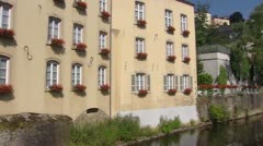 River Alzette in Luxembourg City quarter Grund + pan Stock Footage