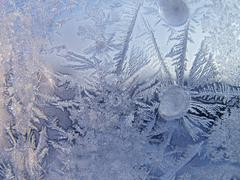 Ice pattern on winter glass - stock photo