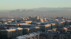 Sunrise over the city. Real time. Urban cityscape. Stock Footage