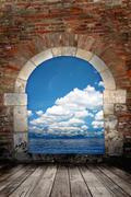 door to the ocean with blue sky - stock photo