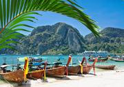Stock Photo of traditional thai longtail boat on the beach of phi phi don