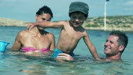 Happy family having fun in the sea, slow motion shot at 240fps Stock Footage