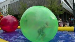 Girl kid zorb ball swim pool vilnius gediminas prospect festival Stock Footage