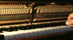 Piano mechanics inside hammers strings Stock Footage