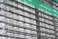 Stock Photo of scaffolding with green net