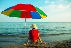 teen girl seating at a beach - stock photo