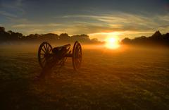 Civil War Cannon with golden sunrise - stock photo