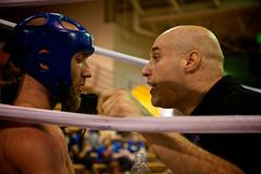 Muay Thai Fighter gets directions from his cornerman - stock photo