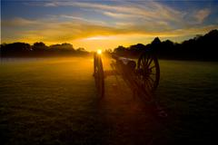 Civil War Cannon with sun rising in the distance - stock photo