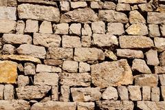 Stone wall of irregular pieces Stock Photos