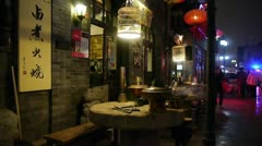 Stock Video Footage of china tradition gourmet,chafing dish on stone mill,beijing alley street.