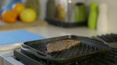 Steak comes out of pan Stock Footage