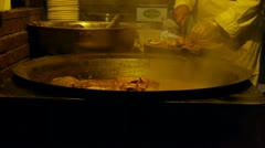 China tradition gourmet,pot roast in cauldron,chef cutting cooked meat. Stock Footage