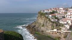Cape Boca do Inferno  + village on steep cliff Stock Footage