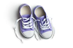 purple baby sneakers - stock photo