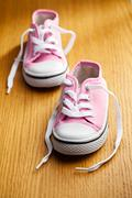 pink baby sneakers - stock photo